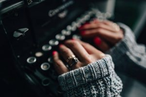 hands at a typewriter
